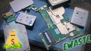 Destroying Hard Drives and Taking Apart An HP Touchscreen Laptop At An Electronic Recycling Business